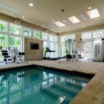 luxurious home gym essentials with pool inside