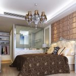 luxurious master bedroom design idea with bold bedding and brown sheet and wall panel and closet idea