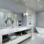 Luxurious Modern Bath Idea With Concrete Vanity With Indoor Plant And Unique Bathtub And Wall Lamps