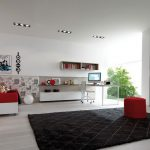 luxurious red and white simple interior design with red bedding and black area rug and floating shelves and glass window and red floor lamp