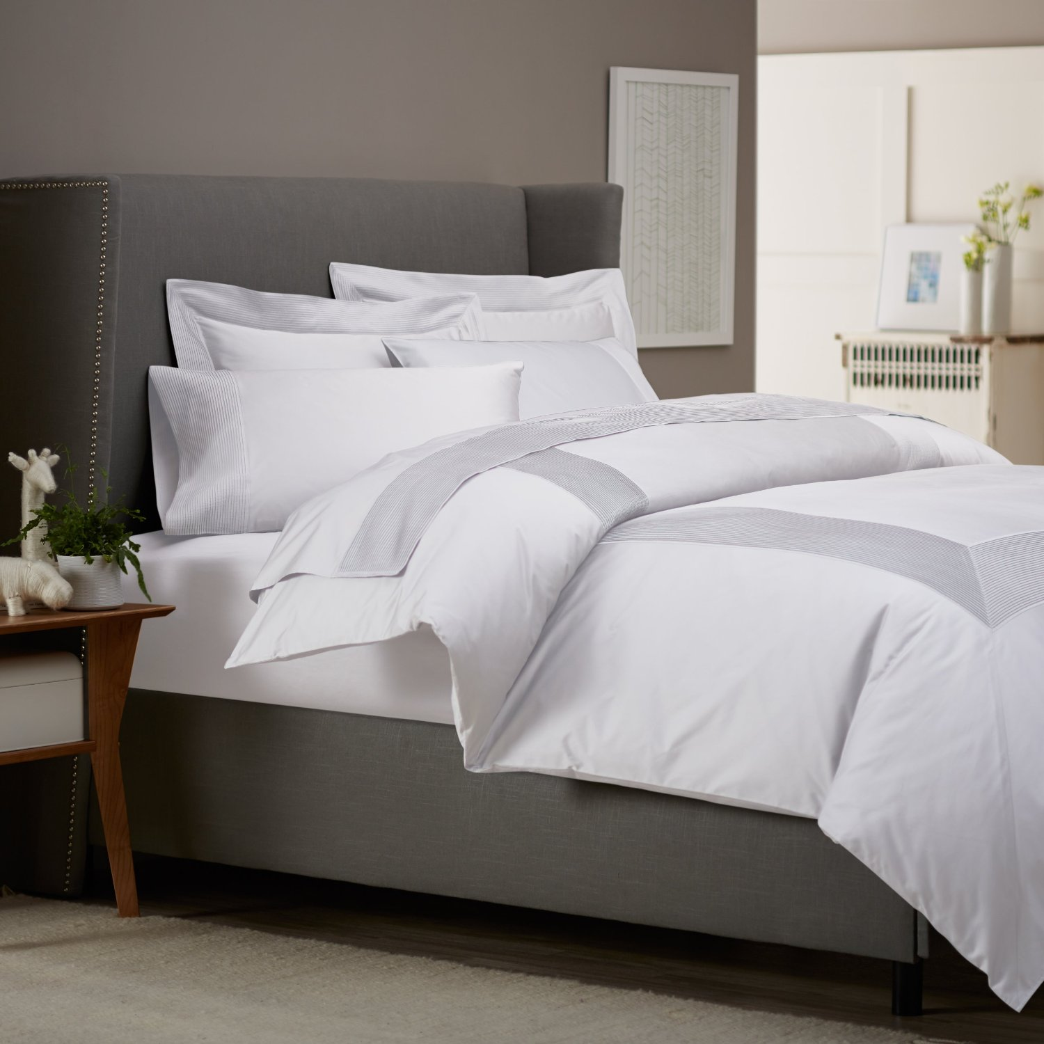 Get Alluring Visage by Displaying a White Comforter Sets  : masculine white comforter sets king arranged on a divan bed with gray fabric and nailhead with wooden night table from homesfeed.com size 1500 x 1500 jpeg 180kB