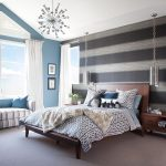 modern and chic bedroom wallpaper accent wall design with gray white wallpaper accent and soft blue painted wall and banquette and leopard sheet