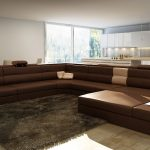 modern and minimalist interior design with long sectional sofa design with furry area rug and wooden floor and glass window