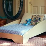 modern bed frame for toddler in modern style oval decorative mirror with black crafted wooden frame