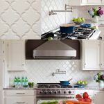 modern kitchen ideas with beveled arabesque tile in the backsplash plus stainless appliances and contemporary kitchen cabinets