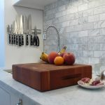 modern-kitchen-room-with-magnetic-strip-knives-mounted-on-the-side-wall-uncer-cabinet-and-above-the-sink