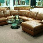 neutral brown sectional sofa clearance made of leather combined with round glass top coffee table and grey area rug