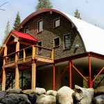 nice looking quonset hut homes with deck and natural stone wall plus glass windows