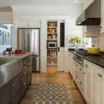 patterned creamy rug and mat design on wooden floor and white cabinet with black t