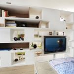 perfect wall sider of bookshelves in apartment interior design with wooden floor and brown curtain idea