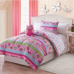 playful pink bedroom design with sketchy owl bedding set in pink green and blue combination with owl doll and white headboard and end table
