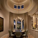 posh vaulted ceiling design of american house design with large creamy curtain idea and a set of gray dining table and tile flooring idea and wall cabinet