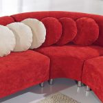 red microfiber sectional set with white and red round accent pillows