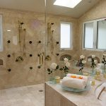romantic shower ideas for master bathroom with elegant shower head and classy bathtub adorned with flower vases
