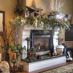 rustic mantel decor for Christmas decoration with  green garland and vintage candle and persian rug plus dried twig