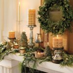rustic mantel decor for chrismast decorated with green garlant and wreath plus elegant candle holders for beautiful home