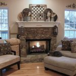 rustic mantel decor made of stone decorated with cozy armchairs plus comfy single couch completed with ottoman for fascinating home ideas