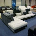 sectional sofa clearance in white and navy upholstery together with comfortable decorative cushions