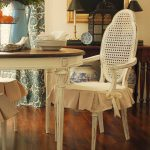shabby chic dining room ideas with  vintage dining chairs adorned with slipcovers for dining room chairs featuring ribbon on its arm
