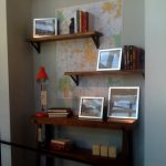 simple and rustic diy wall shelves design with black iron stand on gray wall with map and wooden console table