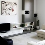simple black and white interior design in the living room with console tv table with seductive picture on the wall