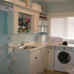 simple softblue laundry room design with white cabinet and wall laundry room shelf idea