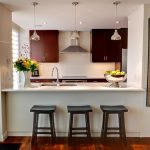 simple wenge kitchen fashion trend with bar and wooden stools and crystal pendants and wooden floor and glass window