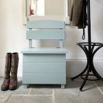 small bench with storage painted turquoise  decorated with cool booth and mirror mounted on the wall