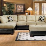 soft ivory apartment sectional sofas with super comfortable upholstery and black leather on its frame together with ottoman as coffee table and patterned rug