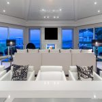 sophisticated mansion design idea with luxurious kitchen bar with white leather stools with cusion and adorable view