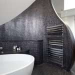 stunning and futuristic trend bathroom design with curver mosaic small tile siding and luxurious white bathtub and tile flooring