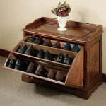 stunning antique wooden shoe storage in the entry with flipped style and carved surface