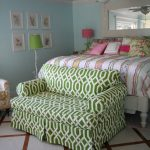 stunning bedroom idea with pink bedding sheet and green patterned loveseat slip cover on tile flooring with ceiling fan