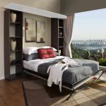 stunning bedroom with open plan and wooeden murphy bed kit lowes idea with gray sheet and red pillow and wooden floor