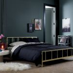 stunning black bedroom design with black sheet and metal platform bed and white faux fluffy rug