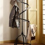 stunning black metal spiral standing coat rack idea with round base and wooden floor