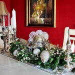 stunning christmas centerpiece design with bronze table cloth white white christmasballs and greenery and candelabrum