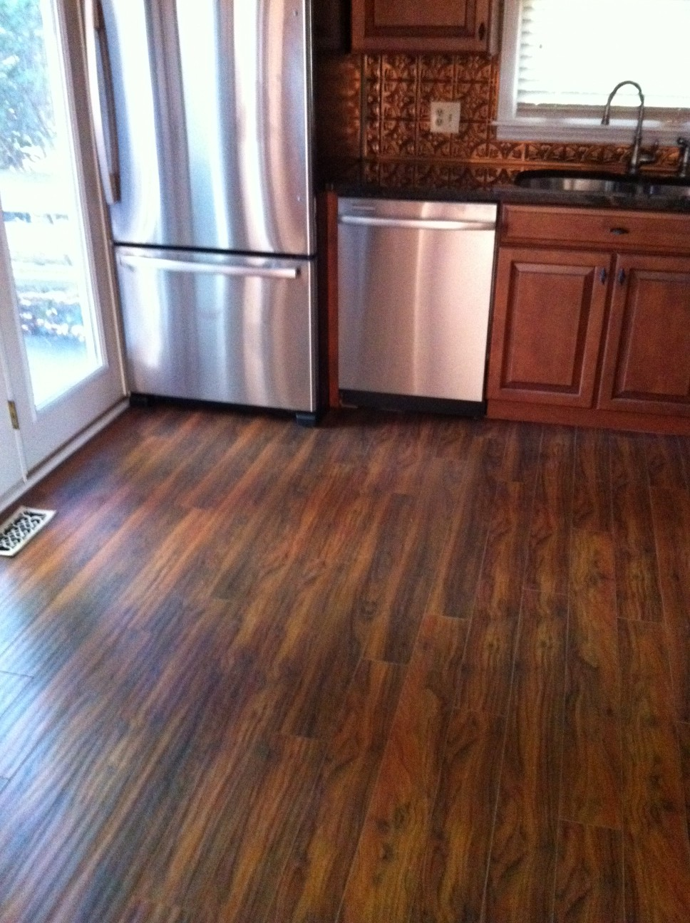 dark laminate flooring in kitchen hardwood floor vs laminate the pros and cons homesfeed 8564