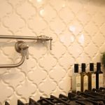 stunning kitchen backsplash with beveled arabesque tile and modern steel faucets decorated with potted plant for fresh kitchen ideas
