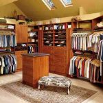 stunning large walk in closet design with wooden storage and dresser for closet and floral patterned bench