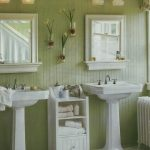 stunning soft green bathroom trend color with freestanding double white vanity with framed wall mirror and towel rack