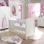 stunning white pink baby nursery idea with wooden floor and white crib and chandelier and faux white fluffy rug