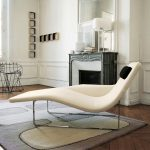 stunning white small chaise lounge design with armrests on patterned creamy chair and wooden floor