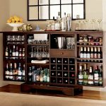 stylish convertible wine rack idea made of wooden material with glass storage beneath black framed bar glass window