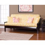 stylish yellow loveseat slipcover design with pink patterned cushion idea with black wooden frame and wooden floor and wall picture