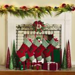 the-charming-wreath-freestanding-christmas-stocking-holder-stand-and-highlighted-with-scrolled-top-and-metal-wreath-place-near-mantel-and-fireplace