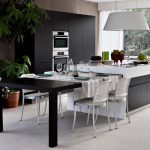 the-functional-and-adaptable-monoblocco-island-a-white-kitchen-island-with-black-pull-out-table-in-various-lengths-for-small-or-large-table