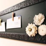 traditional decorative magnetic board in black scheme decorated with handmade decorative flowers