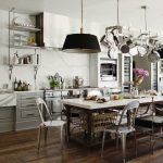traditional kitchen ideas with pot rack with lights above dining area with long shape dining table and unique dining chairs and black pendant lamp