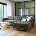 tufted grey apartment sectional sofas with modern design plus metal leg and oval coffee table